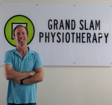 Grand slam physio logo, man in front of logo, physio